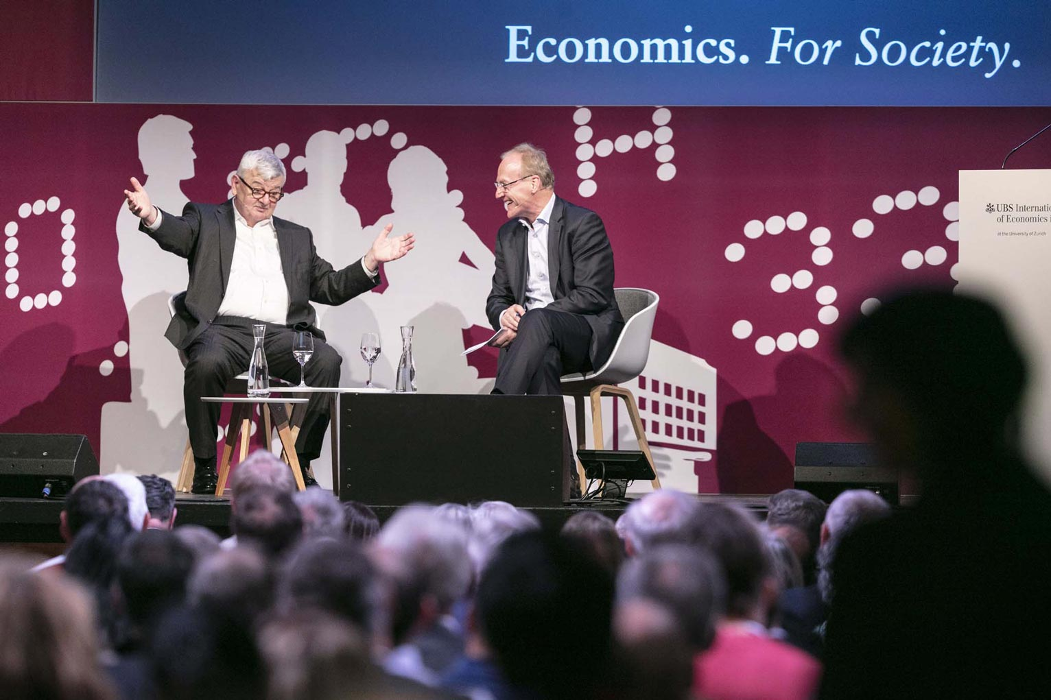 UBS Center Director Ernst Fehr (on the right) in conversation with Joschka Fischer, Former Foreign Minister and Vice Chancellor of Germany.